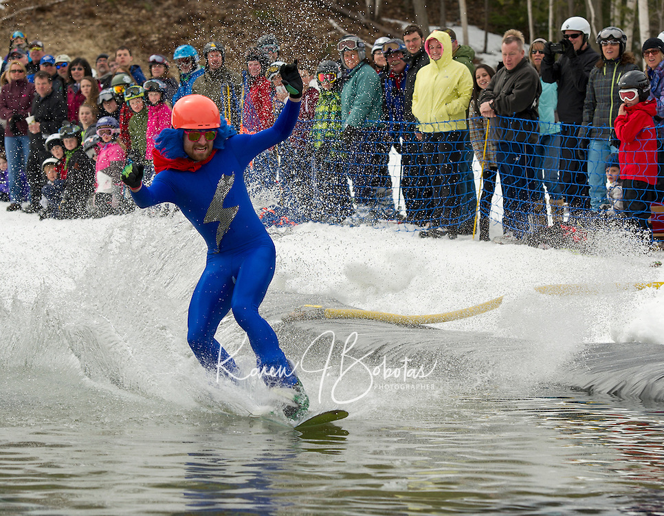 """""""Electric Blue"""" Shaun Dever of Meredith skims the pond during the Bring Your Own Dry Clothes race Sunday afternoon at Gunstock Mountain to celebrate their final day of the season.  (Karen Bobotas/for the Laconia Daily Sun)"""