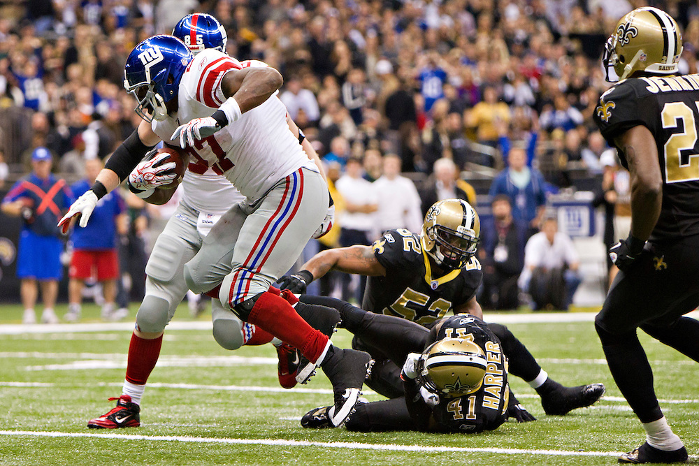 NEW ORLEANS, LA - NOVEMBER 28:   Brandon Jacobs #27 of the New York Giants runs the ball in for a touchdown against the New Orleans Saints at Mercedes-Benz Superdome on November 28, 2011 in New Orleans, Louisiana.  The Saints defeated the Giants 49-24.  (Photo by Wesley Hitt/Getty Images) *** Local Caption *** Brandon Jacobs