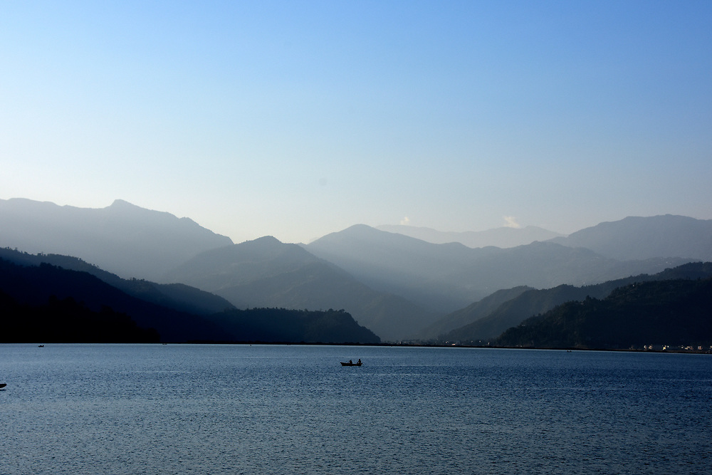 Hills and lake Pewa, Pokhara, Nepal as the sun goes down