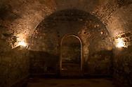 Candles illuminate the interior of Fort San Lorenzo, Panama.