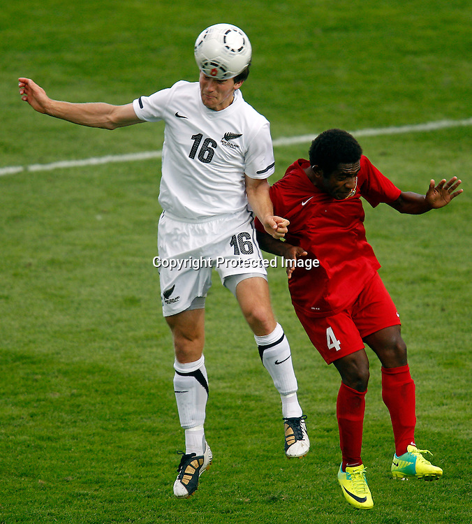 NZ's Tristan Prattley beats PNG's Daniel Joe. OFC Men's Olympic Qualifier New Zealand 2012, New Zealand v Papua New Guinea, Owen Delany Park Taupo, Friday 16th March 2012. Photo: Shane Wenzlick