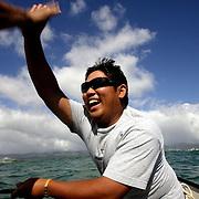 HONOLULU, HAWAII, November 8, 2007: Tadd Fujikawa, a sixteen-year-old professional golfer, fishes off the coast of Honolulu, Hawaii . (Photographs by Todd Bigelow/Aurora)