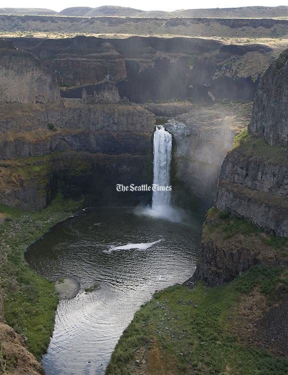 As many as 100 ancient floods roaring through the Northwest at the end of the last Ice Age carved much of the landscape we see today, including Palouse Falls. Here, the Palouse River drops 198 feet before it enters the Snake River in Eastern Washington. (Steve Ringman / The Seattle Times)