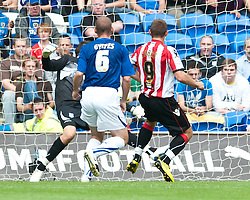 CARDIFF, WALES - Sunday, August 8, 2010: Sheffield United's Ched Evans scores the opening goal against Cardiff City during the League Championship match at the Cardiff City Stadium. (Pic by: David Rawcliffe/Propaganda)