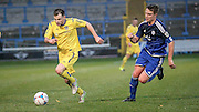 Will Hatfield (Guiseley) runs past Nicky Wroe (c) (Halifax) during the Conference Premier League match between FC Halifax Town and Guiseley at the Shay, Halifax, United Kingdom on 5 December 2015. Photo by Mark P Doherty.