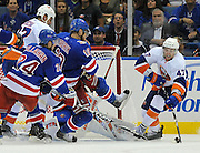 New York Islanders' Andrew MacDonald (47) drives the puck away from New York Rangers' Ryan Callahan (24) and Marian Gaborik (10) during an NHL hockey game Monday, Oct. 11, 2010, in Uniondale, New York. (AP Photo/Kathy Kmonicek)