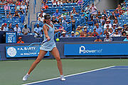 Maria Sharapova (RUS) hits a forehand to Ashleigh Barty (AUS) during the Western and Southern Open tennis tournament at Lindner Family Tennis Center, Wednesday, Aug 14, 2019, in Mason, OH. (Jason Whitman/Image of Sport)
