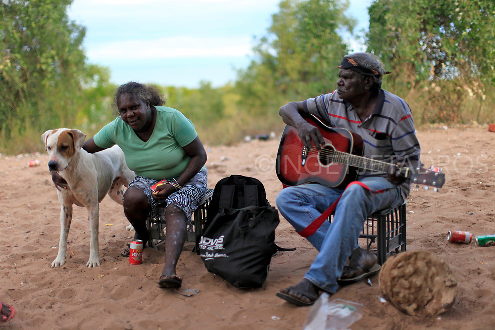A couple spending time in the sand dunes in Kennedy Hill. Many Aboriginal people gather here, to carve boab nuts, drink, socialise and play music. The Mallingbarr (Kennedy Hill) community, Broome, WA