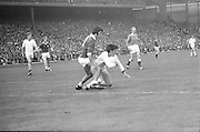 Cork falls to the ground when tackled by Galway during the All Ireland Senior Gaelic Football Championship Final Cork v Galway in Croke Park on the 23rd September 1973. Cork 3-17 Galway 2-13.