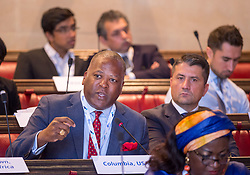 © Licensed to London News Pictures. 22/10/2018. Bristol, UK. Global Parliament of Mayors Annual Summit, 21-23 October 2018, at Bristol City Hall. Picture of STEVE BENJAMIN, Mayor of Colombia, South Carolina, USA, taking part in the plenary session on harnessing the power of migration. The Global Parliament of Mayors 2018 is the biggest and most ambitious Annual Summit to date. GPM Bristol 2018 will host up to 100 global mayors for an action-focused summit that addresses some of the biggest challenges facing today's world cities. GPM Bristol 2018's theme, Empowering Cities as Drivers of Change, will focus minds on global governance and the urgent need for the influence, expertise and leadership of cities to be felt as international policy is shaped. GPM Bristol 2018 will provide mayoral delegates with a global network of connections and a space to develop the collective city voice necessary to drive positive change. The programme will engage participants in decision-making, with panels, debate and voting on priority issues including migration and inclusion, urban security and health, and is a unique chance to influence decisions on the most pressing issues of our time. Photo credit: Simon Chapman/LNP
