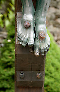 nails through the feet of Christ on the cross