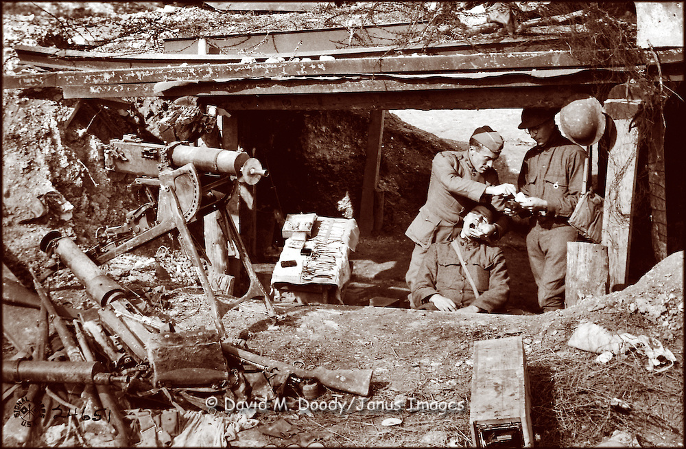 WWI, Americans in the Argonne, France.Army Dentist at work in a smashed machine gun nest