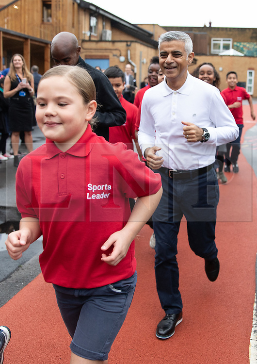 © Licensed to London News Pictures. 15/10/2018. London, UK. Mayor of London Sadiq Khan and British athlete Sir Mohamed Farah (not pictured) launch a campaign at Cubitt Town Junior School to encourage London schools to take part in the Daily Mile initiative. The Daily Mile gets school children exercising outside for 15 minutes a day, to improve their physical, social, emotional and mental health and wellbeing. Photo credit : Tom Nicholson/LNP