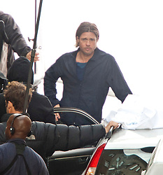 "Day 2. Brad Pitt on the set of the movie ""World War Z"" being shot in the city centre of Glasgow. The film, which is set in Philadelphia, is being shot in various parts of Glasgow, transforming it to shoot the post apocalyptic zombie film..© pic : Michael Schofield."