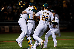 OAKLAND, CA - MAY 07: Mike Fiers #50 of the Oakland Athletics celebrates with Josh Phegley #19, Matt Olson #28 and Matt Chapman #26 after pitching a no hitter against the Cincinnati Reds at the Oakland Coliseum on May 7, 2019 in Oakland, California. The Oakland Athletics defeated the Cincinnati Reds 2-0. (Photo by Jason O. Watson/Getty Images) *** Local Caption *** Mike Fiers; Josh Phegley; Matt Olson; Matt Chapman