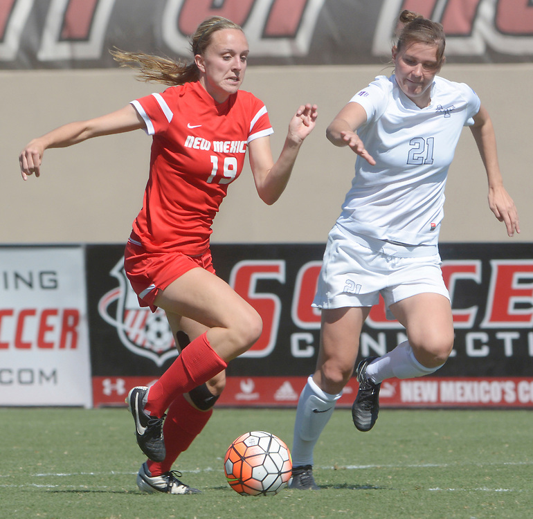 gbs092516y/SPORTS -- UNM's Annie Wheeler, 19 and Air Force's Kristina O'Sullivan,21, chase the ball during the game at the UNM Soccer Complex on Sunday, September 25, 2016. Air Force won 2-1.(Greg Sorber/Albuquerque Journal)