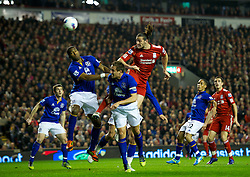 LIVERPOOL, ENGLAND - Tuesday, March 13, 2012: Liverpool's Andy Carroll in action against Everton's Sylvain Distin and captain Phil Jagielka during the Premiership match at Anfield. (Pic by David Rawcliffe/Propaganda)
