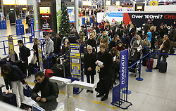 Passengers checking in at Stansted airport at the start of the Christmas getaway, Friday, 21st December 2012  Photo by: Stephen Lock / i-Images