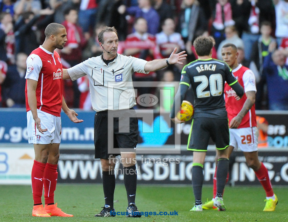 Jordan Bowery of Rotherham United is ushered from the field by Referee Mick Russell after being shown a red card during the Sky Bet Championship match at the New York Stadium, Rotherham<br /> Picture by Richard Land/Focus Images Ltd +44 7713 507003<br /> 01/11/2014