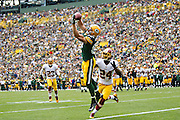 GREEN BAY, WI - SEPTEMBER 15:  Jordy Nelson #87 of the Green Bay Packers catches a touchdown pass over Bacarri Rambo #24 of the Washington Redskins at Lambeau Field on September 15, 2013 in Green Bay, Wisconsin.  The Packers defeated the Redskins 38-20.  (Photo by Wesley Hitt/Getty Images) *** Local Caption *** Jordy Nelson; Bacarri Rambo Sports photography by Wesley Hitt photography with images from the NFL, NCAA and Arkansas Razorbacks.  Hitt photography in based in Fayetteville, Arkansas where he shoots Commercial Photography, Editorial Photography, Advertising Photography, Stock Photography and People Photography