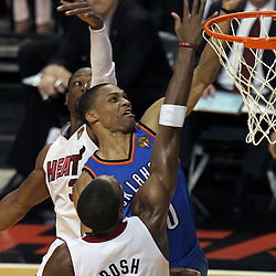 Jun 21, 2012; Miami, FL, USA; Oklahoma City Thunder point guard Russell Westbrook (0) shoots against Miami Heat power forward Chris Bosh (1) during the third quarter in game five in the 2012 NBA Finals at the American Airlines Arena. Mandatory Credit: Derick E. Hingle-US PRESSWIRE