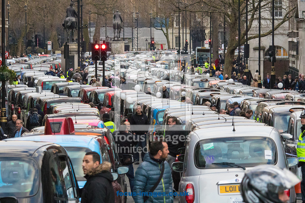 Taxis line whitehall in both directions as an estimated 8,000 cabbies protest against &quot;unfair competition&quot; from Uber mini cabs<br /> Picture by Paul Davey/Focus Images Ltd +447966 016296<br /> 10/02/2016