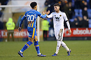 Shrewsbury Town's Aaron Holloway and Wolverhampton Wanderers defender Matt Doherty (2) shake hands after the  The FA Cup fourth round match between Shrewsbury Town and Wolverhampton Wanderers at Greenhous Meadow, Shrewsbury, England on 26 January 2019.