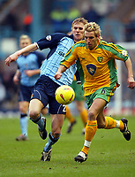 Photo: Scott Heavey.<br />Coventry v Norwich. Nationwide Division One. 14/02/2004.<br />Darren Huckerby is chased by Calum Davenport