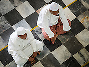 19 JUNE 2015 - PATTANI, PATTANI, THAILAND:  Men wait for Friday midday prayers to start in Pattani Central Mosque. Pattani Central Mosque is the main mosque in Pattani and was built in 1963. It is especially crowded during Ramadan, when the crowd frequently spills out into the street.     PHOTO BY JACK KURTZ