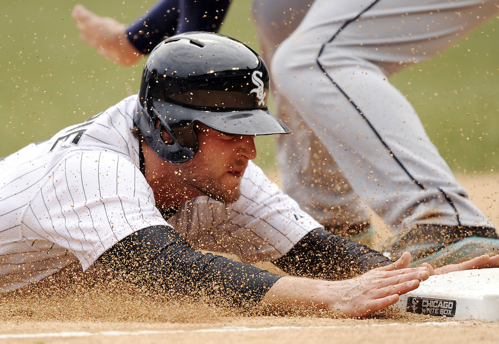 CHICAGO - APRIL 06:  Conor Gillaspie #12 of the Chicago White Sox slides headfirst into third base with a triple in the fifth inning against the Seattle Mariners on April 06, 2013 at U.S. Cellular Field in Chicago, Illinois.  The White Sox defeated the Mariners 4-3.  (Photo by Ron Vesely)   Subject:  Conor Gillaspie