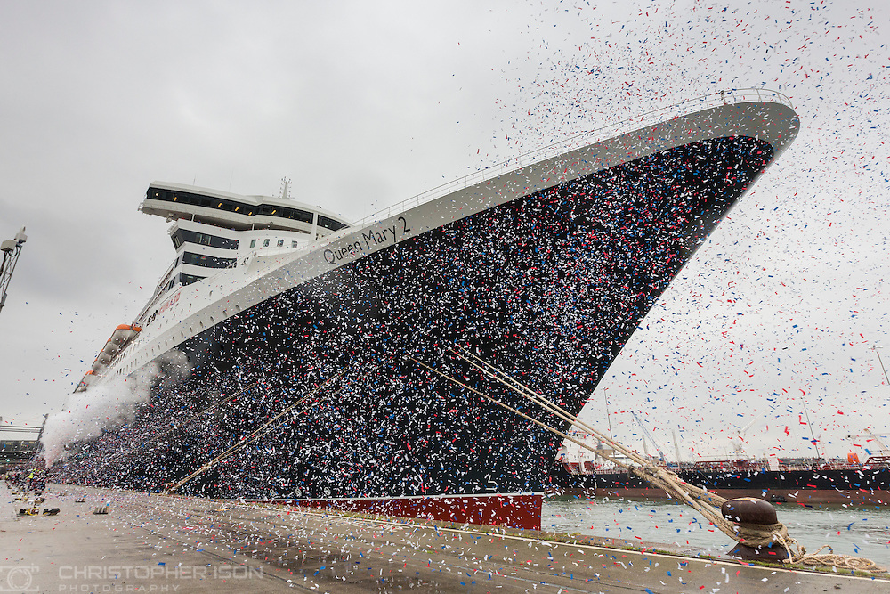 Confetti flutters under the bow of Cunard&rsquo;s Queen Mary 2, as she gets ready to set sail today for New York. It is the ship's first voyage following a &pound;90million remastering, the most significant refurbishment undertaken by the world's most famous passenger shipping line.<br /> Picture date: Thursday June 23, 2016.<br /> Photograph by Christopher Ison &copy;<br /> 07544044177<br /> chris@christopherison.com<br /> www.christopherison.com