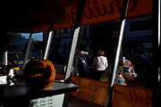 A man shields his eyes from the sun outside of Ben's Chili Bowl along the U Street corridor on Monday, Oct. 16, 2017 in Washington.