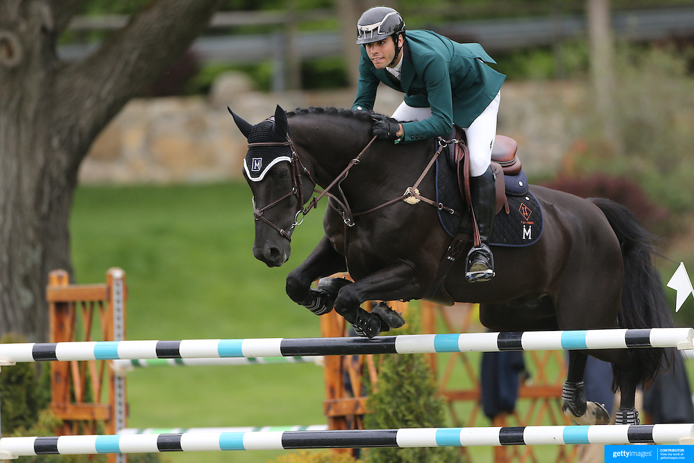NORTH SALEM, NEW YORK - May 21:  Andre Mershad riding Man in Black in action during The $15,000 Under 25 T & R Development Grand Prix at the Old Salem Farm Spring Horse Show on May 21, 2016 in North Salem, New York. (Photo by Tim Clayton/Corbis via Getty Images)