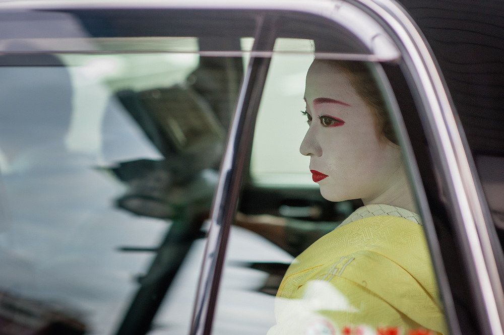 Geisha's face through black cab window in Gion district (Kyoto, Japan)