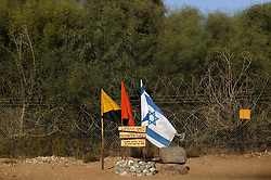 The site of an attack on a female jogger is decorated with flags near Elei Sinai, a northern Jewish settlement, Gaza, Palestinian Territories, Nov. 6, 2004. Two attackers killed the woman in September and an army medic who came to her aid. The gunmen were eventually killed by Israeli troops. Israel's parliament recently supported compensation payments for Jewish settlers leaving the Gaza Strip, in a vital vote for Prime Minister Ariel Sharon's plan to evacuate the occupied territory.