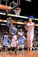 Mar 21, 2016; Phoenix, AZ, USA; Memphis Grizzlies guard Ray McCallum (5) drives the ball against Phoenix Suns center Alex Len (21) in the second half at Talking Stick Resort Arena. The Memphis Grizzlies won 103-97. Mandatory Credit: Jennifer Stewart-USA TODAY Sports