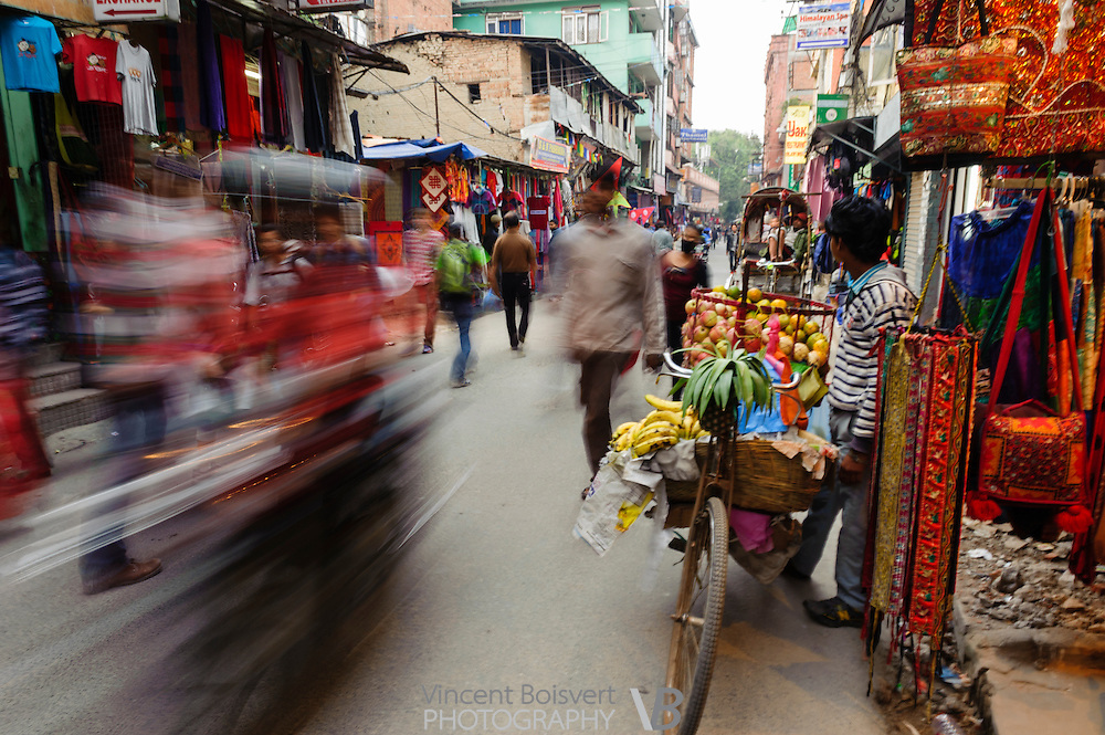 fast moving traffic in Kathmandu narrow street, Nepal