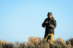 Wildlife photojournalist Noppadol Paothong at work in Wyoming near White Mountain. ©John L. Dengler / DenglerImages.com