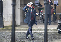 © Licensed to London News Pictures. 22/01/2020. London, UK. Former Foreign Secretary Jeremy Hunt loosens his cycle helmet as he arrives at Parliament ahead of Prime Minister's Questions. Photo credit: Peter Macdiarmid/LNP