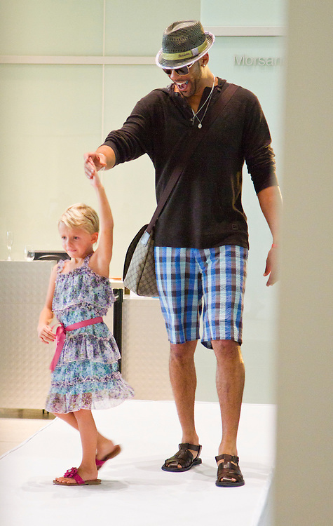 TP_340310_FREE_RAYSRUNWAY_..Caption:(Wednesday 06/29/2011 Tampa)Rays pitcher David Price spins six-year-old Ella Bell as she nervously walks the runway during the fashion show. After being treated for Wilm's tumor Bell received a Disney cruise as her dream. Members of the Tampa Bay Rays and their wives walk the runway escorting children with life-threatening illnesses during the annual Rays on the Runway fashion event at the Tampa Museum of Art on Wednesday, June 29, to benefit the Children's Dream Fund. The show featured fashions by Saks Fifth Avenue. ..Summary:Tampa Bay Rays and their wives walk the runway escorting children with life-threatening illnesses during the annual Rays on the Runway fashion event at the Tampa Museum of Art...Photo by James Branaman
