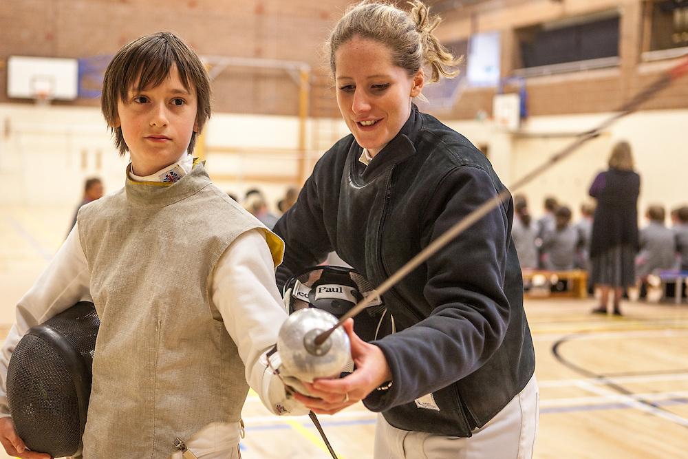 Corinna Lawrence, 2012 Olympic fencing hopeful helps Peter Jones.
