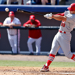 Mar 8, 2013; Melbourne, FL, USA; St. Louis Cardinals second baseman Greg Garcia (89) hits a one run single scoring Rob Johnson during the top of the third inning of a spring training game at Space Coast Stadium. Mandatory Credit: Derick E. Hingle-USA TODAY Sports