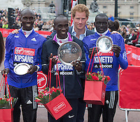 Elite Men's winner Eliud Kipchoge is joined by HRH Prince Harry and 2nd place winner Wilson Kipsang and third place Dennis Kimetto during the medal presentation at The Virgin Money London Marathon, Sunday 26th April 2015.<br /> <br /> Photo: Jon Buckle for Virgin Money London Marathon<br /> <br /> For more information please contact Penny Dain at pennyd@london-marathon.co.uk