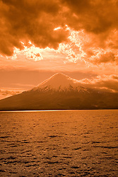 Chile, Lake Country: View of Osorno Volcano while riding across Lake Todos Los Santos..Photo #: ch636-33994..Photo copyright Lee Foster www.fostertravel.com, lee@fostertravel.com, 510-549-2202.