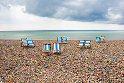 © Licensed to London News Pictures. 11/05/2019. Brighton, UK. Deckchairs stand unused on the beach in Brighton and Hove as colder weather and the occasional rain showers are hitting the seaside resort. Photo credit: Hugo Michiels/LNP
