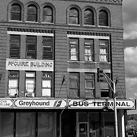 Black and white image of an old building housing the Greyhound Bus Terminal, Bangor, Maine, USA. Bangor is the 3rd largest city in the state and the retail, cultural and service center for central, eastern and northern Maine, as well as Atlantic Canada.