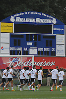 Football - Real Madrid Training for St. Louis Game against Inter Milan.  The Real Madrid team held a practice session on Thursday August 8, 2013 in St. Louis, Missouri, USA at the Robert Hermann Stadium located on the campus of St. Louis University in St. Louis.  Here, players jog in front of the SLU Billikens scoreboard.
