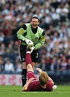 Photo: Andrew Unwin.<br /> Hearts v Gretna. Tennants Scottish Cup Final. 13/05/2006.<br /> Gretna's goalkeeper, Alan Main, gives treatment to Hearts' Edgaras Jankauskas.