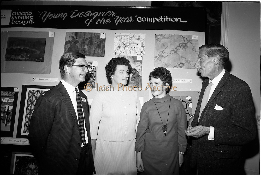 "28/06/1967<br /> 06/28/1967<br /> 28 June 1967<br /> Presentation of prizes at Navan Carpets ""Young Designer of the Year"" reception in the Royal Hibernian Hotel, Dublin. Image shows (l-r): Mr. Wilson, Navan Carpets Ltd.; Mrs O'Sullivan; Miss Judy O'Sullivan, (prize-winner) Co. Cork and Mr. Michael Bourke, Principal of the National College of Art."