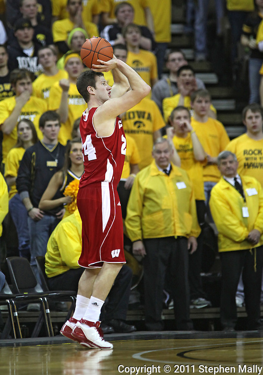 February 09 2011: Wisconsin Badgers guard/forward Tim Jarmusz (24) puts up a shot during the second half of an NCAA college basketball game at Carver-Hawkeye Arena in Iowa City, Iowa on February 9, 2011. Wisconsin defeated Iowa 62-59.